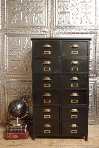 Industrial style black metal 12 drawer unit with brass handles.