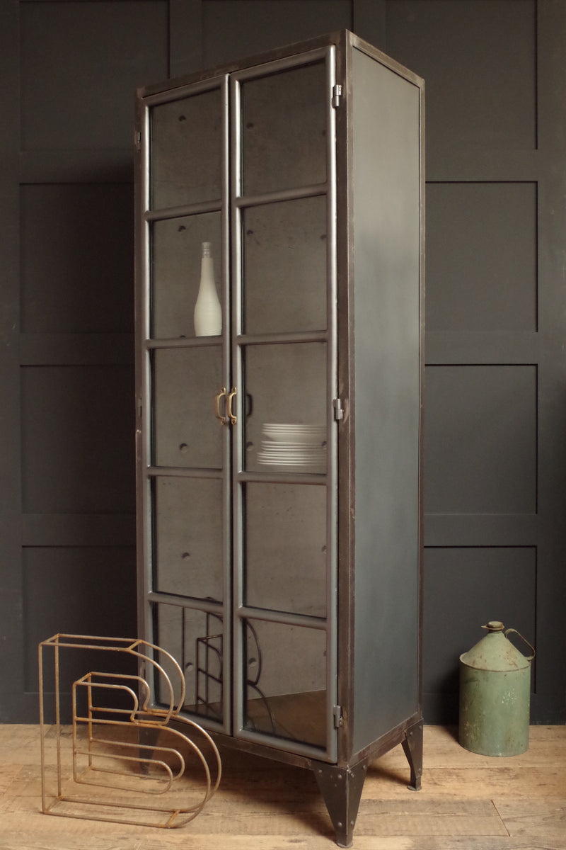 Industrial metal Display Cabinet with glass doors and 4 shelves.