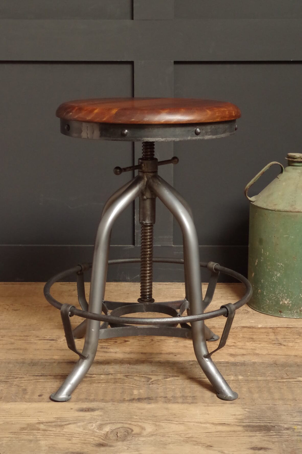 Industrial style Machine Shop Stool. Metal frame and wooden seat.