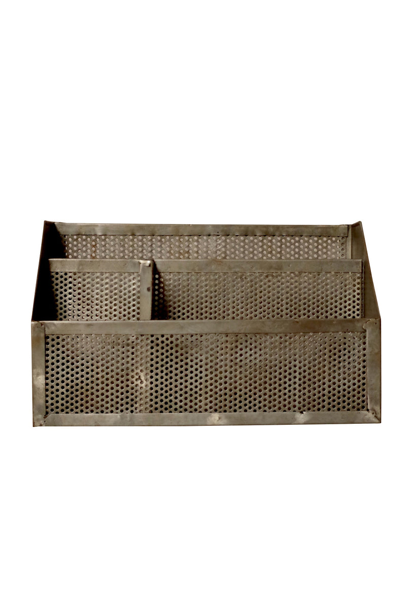 perforated grey metal waste bin.