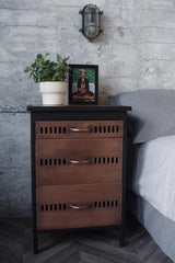 Side table with textured black metal frame with 3 bronze effect perforated drawers