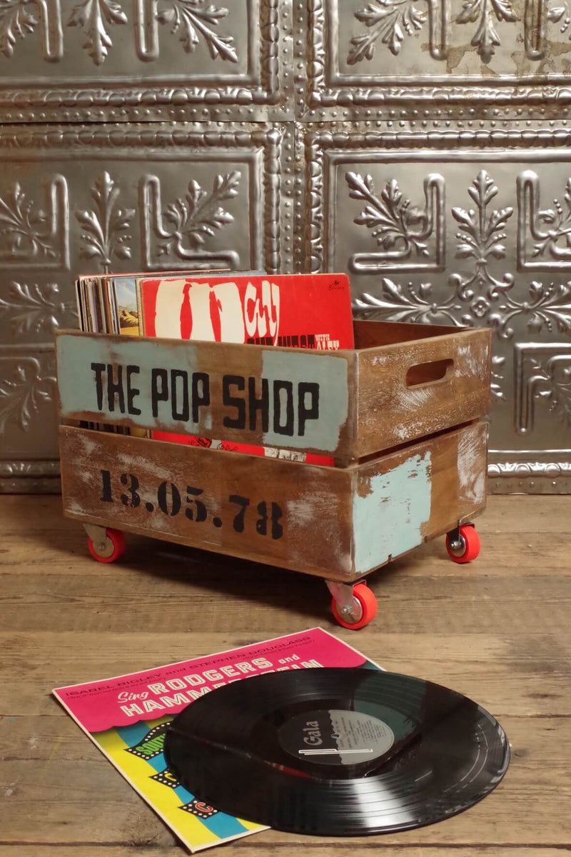 Wooden crate on orange wheels with distressed paint Pop Shop stencil.