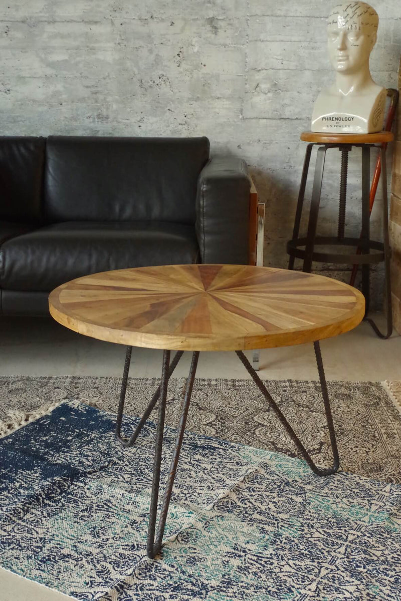 Wood coffee table with rebar metal legs