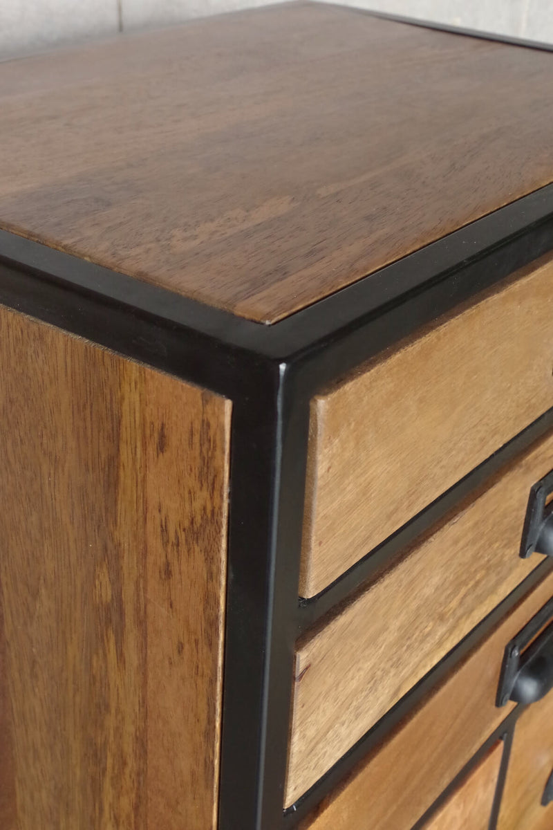Tall drawer unit with 8 square drawers and 3 slim drawers made of wood in a black metal frame.