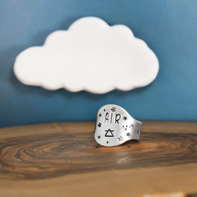 Air Element Ring On Wood With Blue Background with Cloud