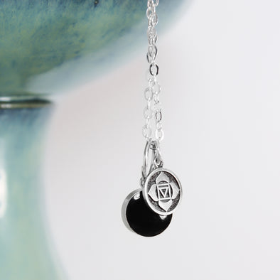 Black tourmaline Root Chakra Necklace on White Background