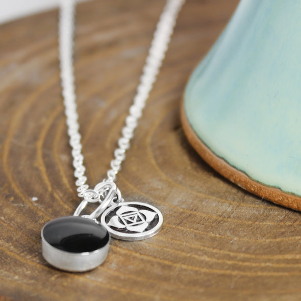 Black tourmaline Root Chakra Necklace on woodBackground