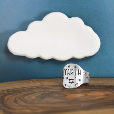 Earth Element Ring On Wood With Blue Background with Cloud
