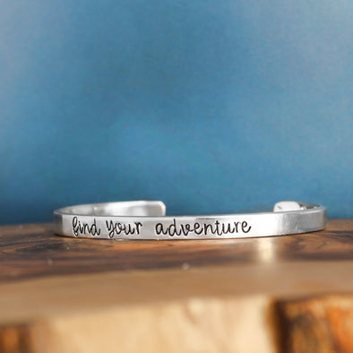 Sterling Silver Inspirational Cuff Bracelet on Blue Background