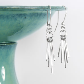 Frayed Dangle Silver Earrings on White Background
