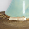 Gold Filled Strong Necklace on Wood Background