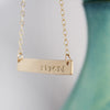 Gold Filled Strong Necklace on white & teal Background