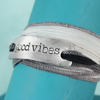 good vibes wrap bracelet on teal background