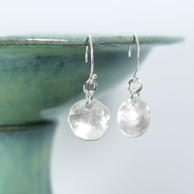 Hammered Silver Drop Earrings on White Background