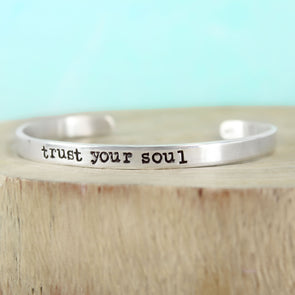 sterling silver inspiration bracelet with teal background