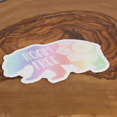 roam free bear sticker on wood