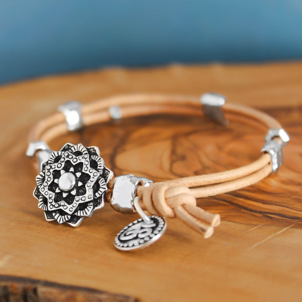 Brown Leather Mandala Wrap Bracelet on Wood Background