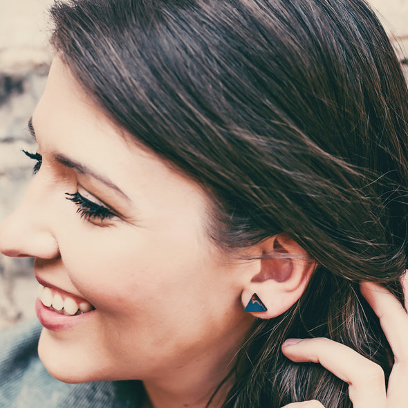 Woman wearing wood mountain earrings