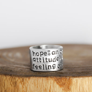 hope inspiration ring on wood block