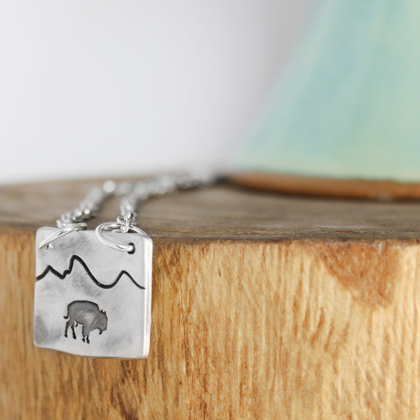 Bison Mountain Necklace on wood and white Background