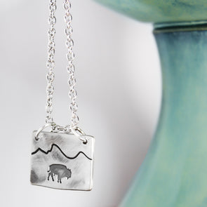 Bison Mountain Necklace on white & teal Background