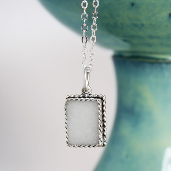 Selenite Ornate Rectangle Necklace with white and teal background