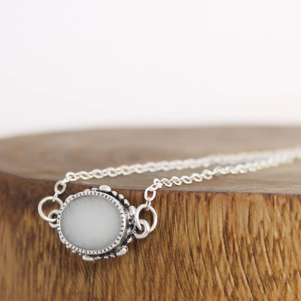 Oval Selenite Necklace on White & wood Background