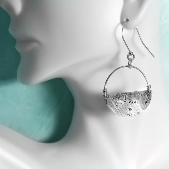 Silver Abstract Earrings on White Background