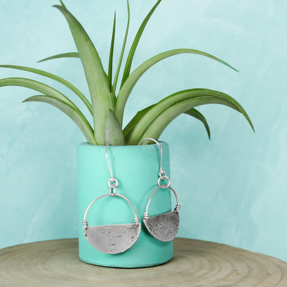 Silver Abstract Earrings on TEal Background