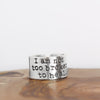 Sterling Silver Inspiration Ring on wood background