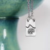 Pewter Bison Necklace on white and teal background