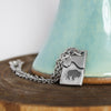 Pewter Bison Necklace on wood and teal background
