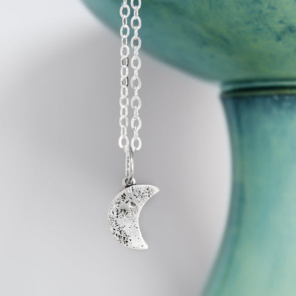 Sterling Silver Crescent Moon Necklace on White background