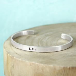 Skinny Sterling Silver Inspiration Bracelet with teal background