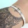 Skinny Sterling Silver Inspiration Bracelet on tattoo'd wrist