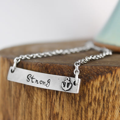 Strong Anchor Necklace on Wood Background
