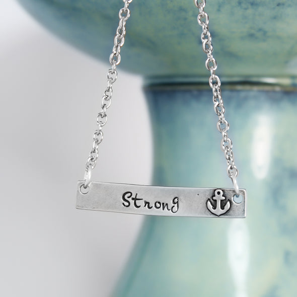 Strong Anchor Necklace on white & teal Background