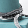 gray silk wrap bracelet on wood bracelet display