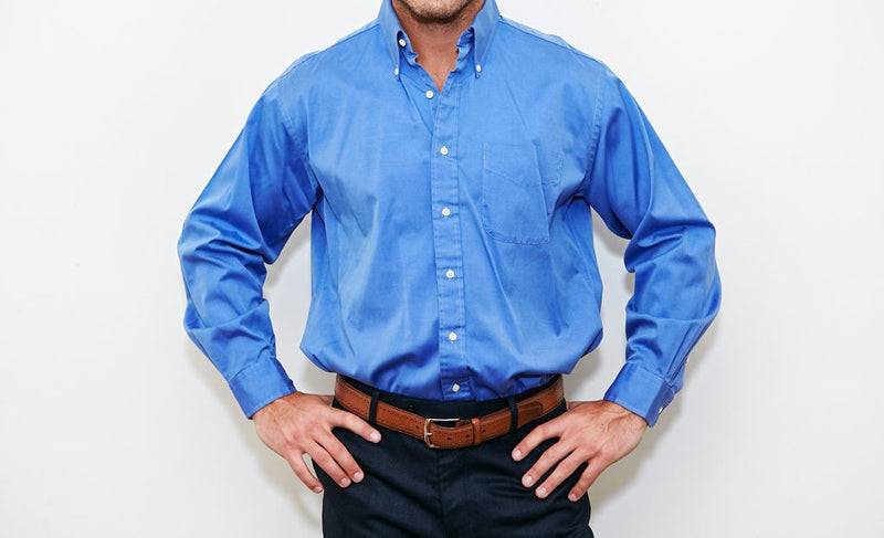A picture of a generic dress shirt that is very poorly fitting, being very big in the waist, chest, hips, and entire body. This dress shirt is very wrinkled to show the problem many people face buying dress shirts.