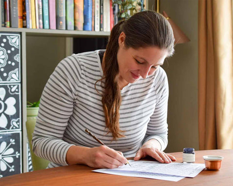 Lindsey Bugbee Writing at Her Desk