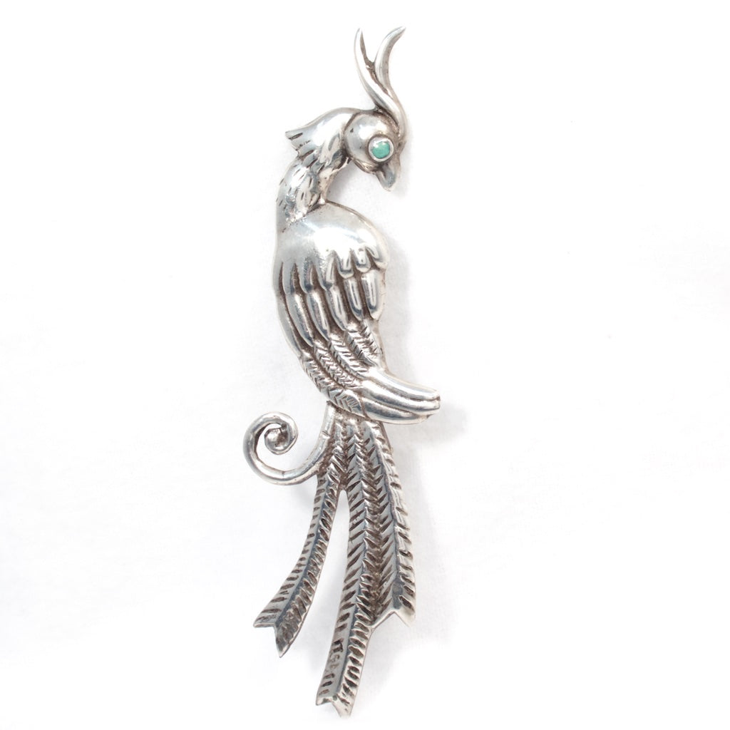Mexican Silver Bird Brooch - Rhinestone Rosie Cast silver brooch featuring a Cockatoo parrot or a Quetzal bird with a turquoise eye.