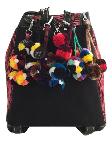 The perfect accessory for your every day. Multi-colored handmade pompom use it as keychain or bag charm. Handmade in Guatemala by skillful artisan women. Fair trade product. Ethical Fashion Brand OLIVIA & ELENA