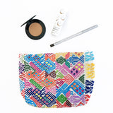 Handmade passport, pencil, makeup bag handmade in Guatemala. Ethical and sustainable fashion brand.