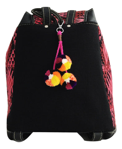 Ethical and sustainable fashion brand. Pompom bag charm. Artisan made keychain, socially conscious product.