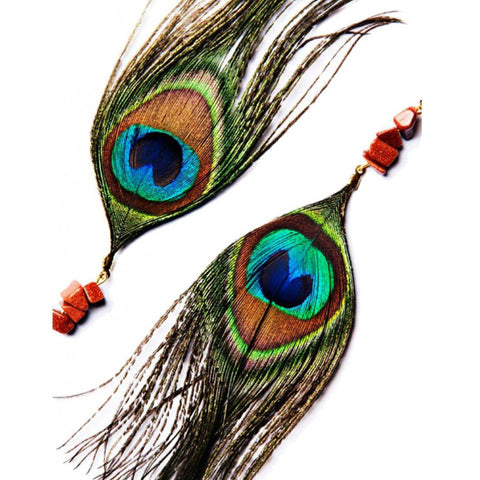 Handmade gorgeous peacock feather earrings accented with coral beads | African handmade feather earrings