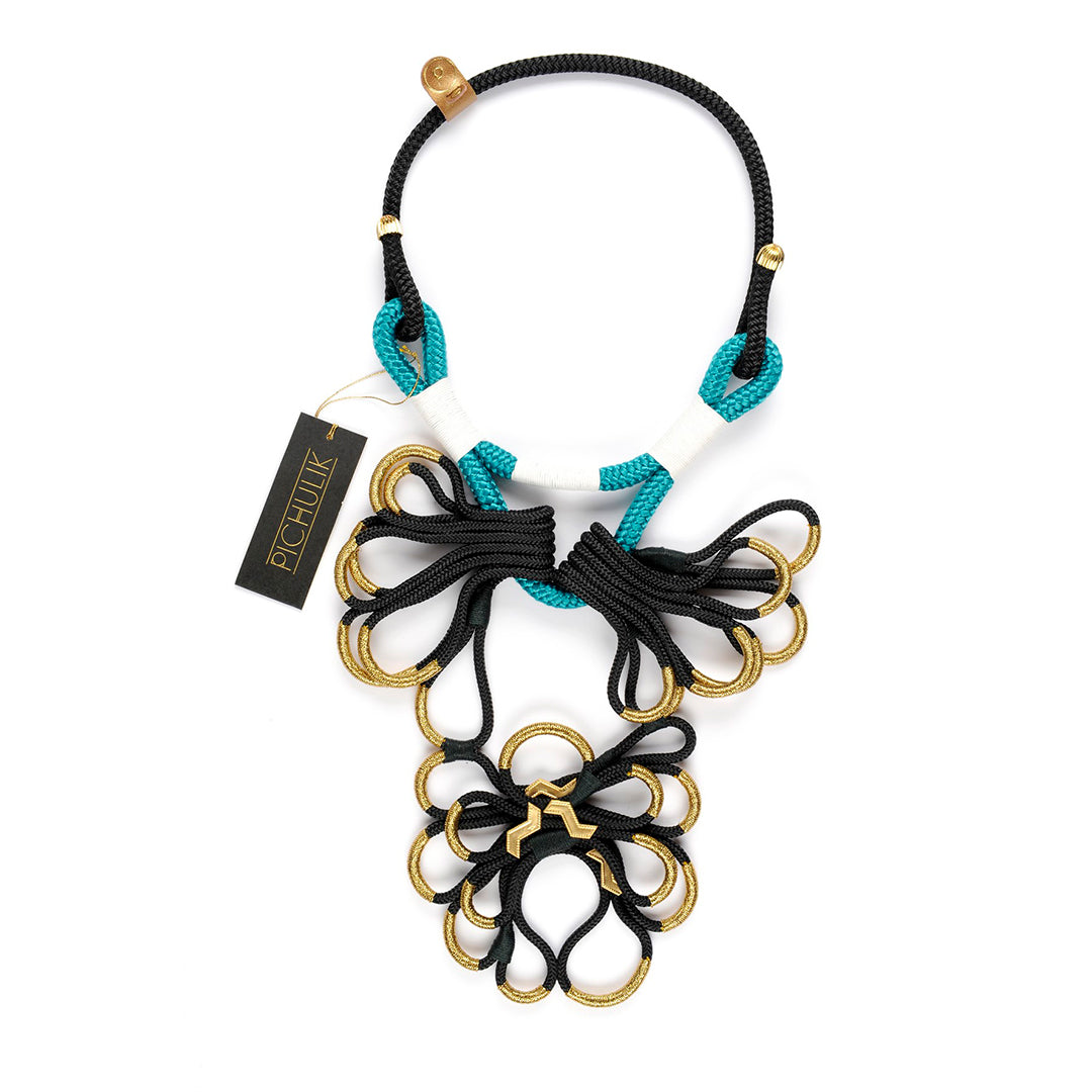 Yoonyq - Handmade African statement rope necklace - handmade necklace in South Africa - The blue green African-inspired rope necklace will elevate any outfit. Flawlessly handcrafted chunky necklace. This statement rope necklace is beautifully handmade in South Africa. Elevate any outfit with this black, blue and gold rope necklace.