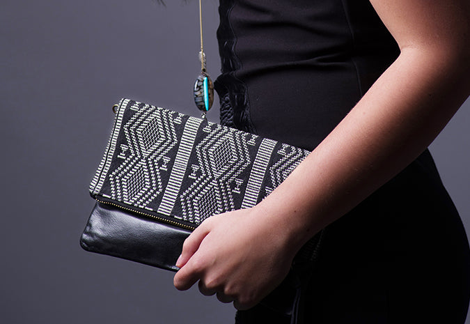 Black patterned fabric and leather clutch purse