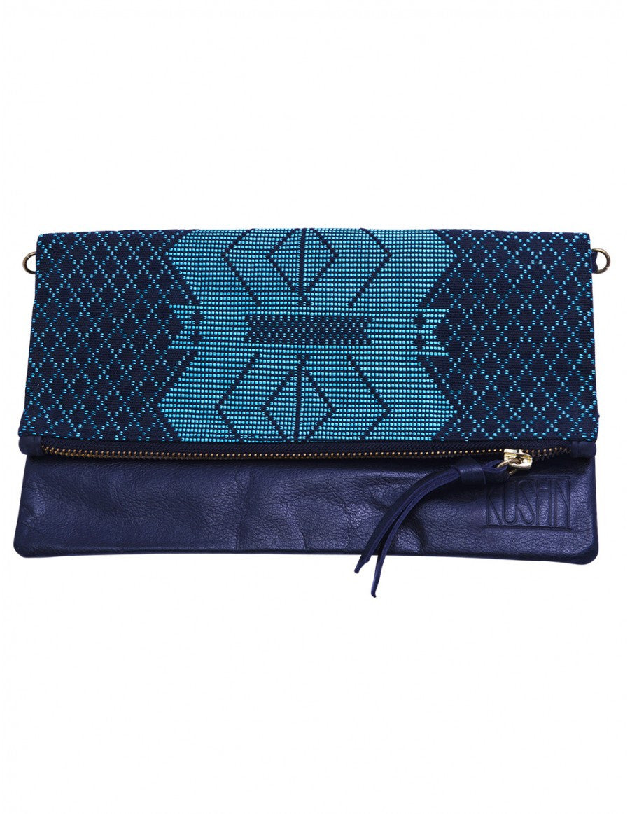 Blue patterned fabric and leather clutch purse