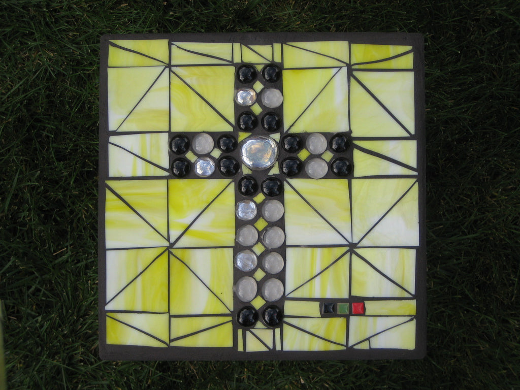 Black and Frosted Cross on Yellow Patio Paver
