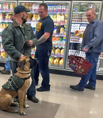 K9s on the Front Line training a dog in a supermarket